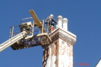 DAN WITH JAMIE RETRFITTING CHIMNIES AT THE GRAND VICTORIAN HOME.JPG