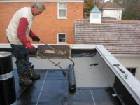EMMANUEL AT FINAL CAP TO A RESIDENTIAL ROOF.JPG