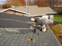 TONY AT A RESIDENTIAL ROOF.jpg